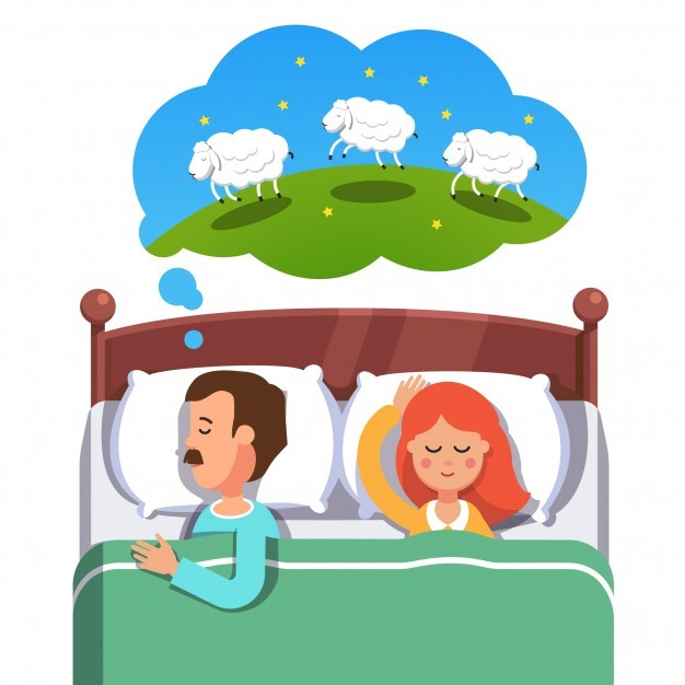 Young couple sleeping in their bed